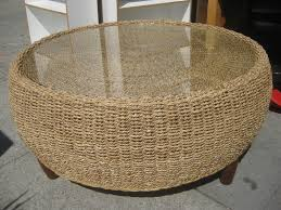 light brown wicker rattan round ottoman glass on top coffee table with dark brown furnished
