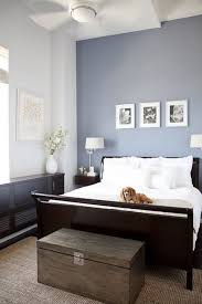 white and dark brown furniture with accent wall