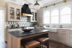 light taupe kitchen cabinets with white marble countertop