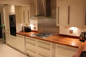 Cream Gloss Kitchen Cream Gloss Kitchen Stainless Steel Splash Back And Walnut Work