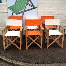 directors chairs in cream and orange canvas