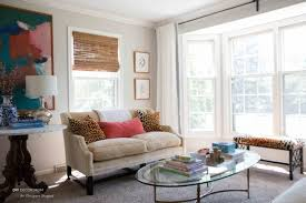 furniture arrangement in a small living room small sofa with bench in front of bay windows