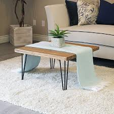 When you build a coffee table with industrial fittings and pipe, almost anything can be used as a tabletop. Hairpin Legs For Coffee Table Diy Elm Coffee Table Coffee Table Wood Round Wood Coffee Table