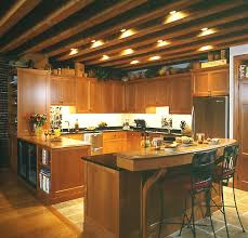 open ceiling lighting. wood ceiling kitchen and furnished by u shaped wooden cabinets a open lighting s