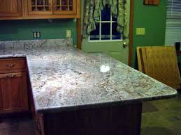 beautiful l shape wooden cabinet in brown paint color with white spring granite countertop