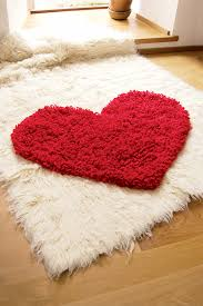 brighten up your home decor with this amazing free crochet rug pattern to make a crochet heart rug that you you will love forever