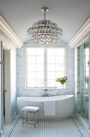 bathroom chandelier lighting ideas. white and gray bathroom features a barrel ceiling accented with tiered crystal chandelier illuminating lighting ideas m