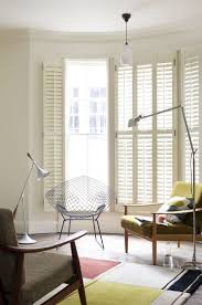 Full height slatted shutters. Source: www.shutterlyfabulous.com