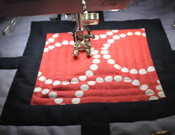 How to Free-Motion Quilt on a Regular Sewing Machine & Sewing on a String of Pearls Quilt Adamdwight.com