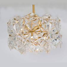 20th century pair of stunning faceted crystal and gilt metal three tier chandelier kinkeldey