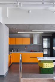 Orange And Concrete Kitchen