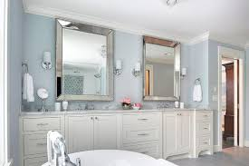 ivory and blue bathroom with beaded beveled mirrors