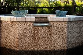 stone and glass mosaic tile water feature