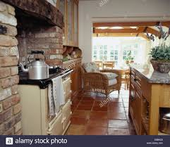 Country Kitchen Floors Large Kettle On Aga Oven In Country Kitchen With Terracotta Tiled