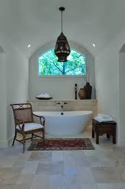 freestanding tub bathroom mediterranean with arched ceiling bathroom shelves ethnic vibe free standing bathtub limestone moroccan bathtub lighting
