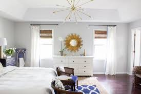 this beautiful custom sputnik chandelier was made by lucent light for this master bedroom makeover as