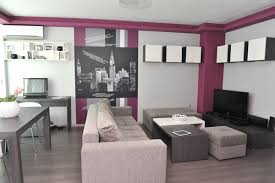 Tiny Apartment in Sofia with Wall Graphic Details Shop this look: canvas,  couch, coffee table.