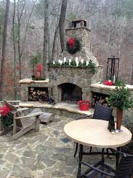 love this outdoor fireplace pointing due west to allow sunset woods with building to left of pic blocking neighbors also love the built in wood holding