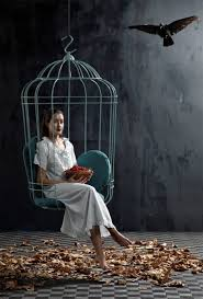 the pillow filled hanging chair looks just like a human sized birdcage with a large opening in the front it hangs from a chain allowing it to sway like a