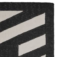 striped border indoor outdoor rug black