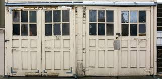 5 signs that let you know it s time to replace old garage door for a new one