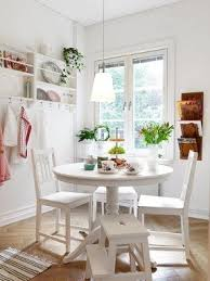 white round kitchen table. bright and cozy dining area white round kitchen table