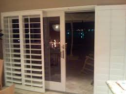 shutters for sliding glass doors with doggie door built in