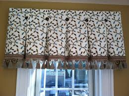 Inverted box pleat valance tacked with bronze nail heads at each ...