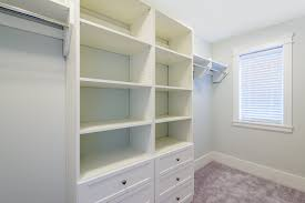 empty walk in closet with white built in drawers in burke va
