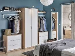 bedroom furniture ikea decoration home ideas: a bedroom with a wardrobe in oak effect with white doors combined with two chest of