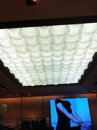 sculptural fluorescent light cover led display