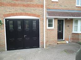 hinged garage doors black