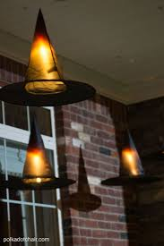 Clever decorating idea for a porch for Halloween, floating Witch's hat  luminaries, they even