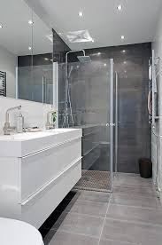grey and white bathroom. white clean modern bathroom gothenburg at its finest: the charming masthuggsliden 22 apartment - like: floor to wall grey tiles. and