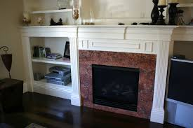 dark brown marble fireplace surrounds and white wooden marble tile fireplace surround