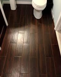 half bathroom floor tile ideas. dark brown subway wood tile bathroom flooring installation also white closet and pedestal sink in half floor ideas