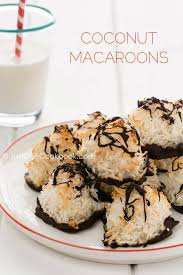 coconut macaroons on a plate and a gl of milk