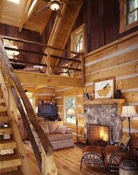 wooden ledder from bottom to the top in the wooden house with fireplace