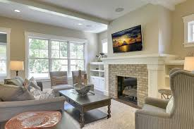 clayton homes lafayette traditional family room and almond walls beige walls brick fireplace built in bookcase dark wood coffee table enameled trim exterior