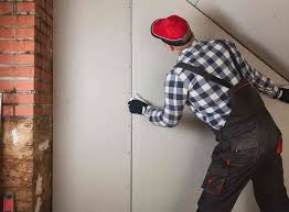what is the cost to put up drywall in