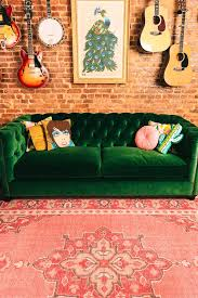tufted furniture trend. living room in progress green tufted velvet sofa and pink rug furniture trend e