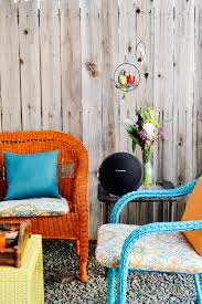 colorful wicker furniture an end table and colorful accents on a backyard patio caribbean furniture