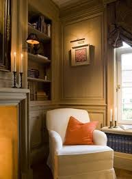home library lighting. framed artwork with picture light and wall lamp in a wood panel library home lighting 7