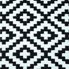 black geometric rug area