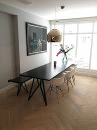 black table living room sweet apartment interior design studio h k design eettafel erfly zwart eikenhout staal all black studio