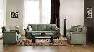 sage green couch and grey walls