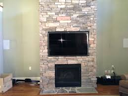 mount flat screen tv above brick fireplace mantelmount attaching to stone patch niche
