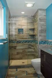 an walk in shower with an eclectic mix of cermaic tile and blue glass mosaics