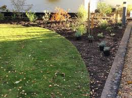 it may seem obvious to lay out the borders in your garden to follow the fence line however that accentuates the shape of the garden defining the