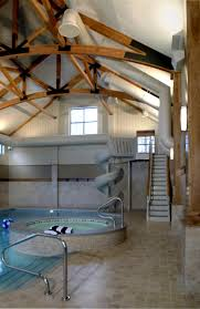 indoor pool and hot tub with a slide. Contemporary House Indoor Pool With Hot Tub Also Spiral Staircase And A Slide F